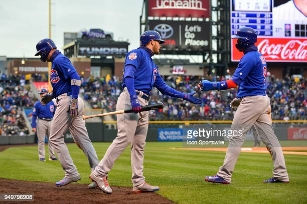 Chicago Cubs second baseman Javier Baez and Chicago Cubs center fielder Albert Almora Jr celebrate with Chicago Cubs second baseman Ian Happ after...