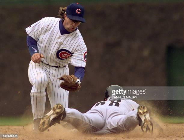 Chicago Cubs second baseman Mickey Morandini puts the tag on Houston Astros infielder Bill Spiers as Spiers attempts to steal second base in the top...