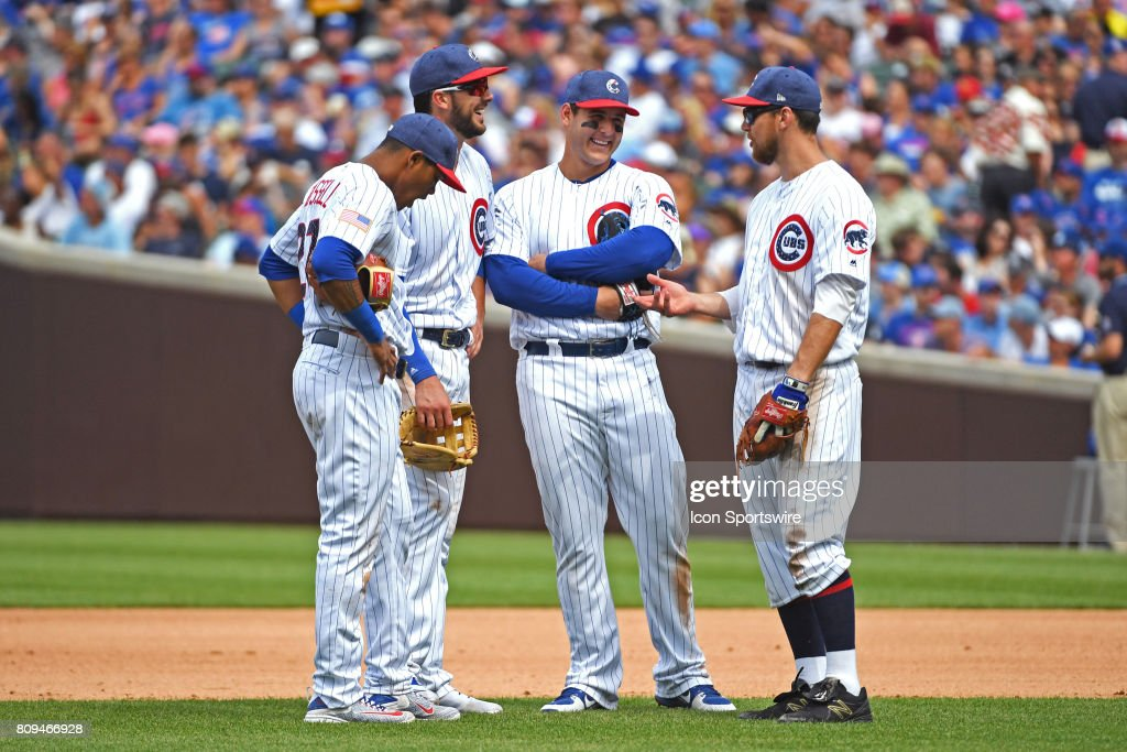 Chicago Cubs shortstop Addison Russell, third baseman Kris Bryant, first baseman Anthony Rizzo, and second baseman Ben Zobrist talk during a pitching change during a game between the Tampa Bay Rays and the Chicago Cubs on July 4, 2017, at Wrigley Field, in Chicago, IL. Rays won 6-5.