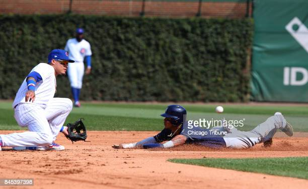 Chicago Cubs shortstop Javier Baez tags out Milwaukee Brewers left fielder Ryan Braun at second on a steal attempt in the fifth inning on Sunday Sept...