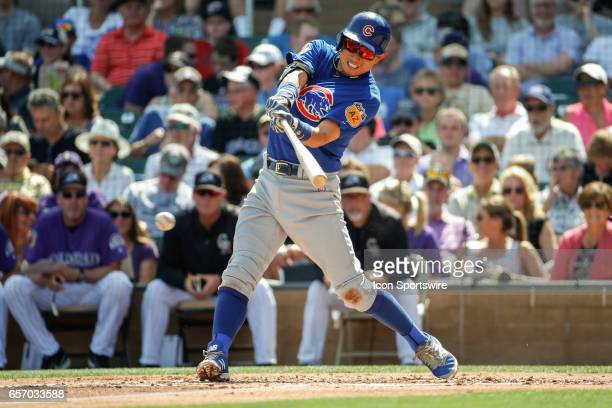 Chicago Cubs shortstop Munenori Kawasaki gets a hit during the spring training baseball game between the Chicago Cubs and the Colorado Rockies on...