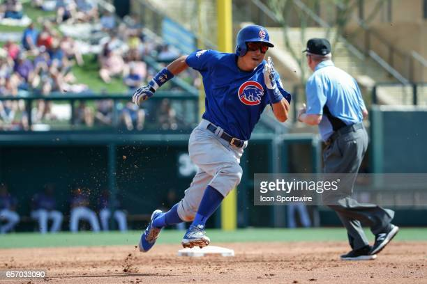 Chicago Cubs shortstop Munenori Kawasaki runs to third base during the spring training baseball game between the Chicago Cubs and the Colorado...