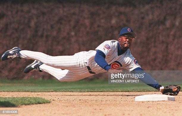 Chicago Cubs shortstop Shawon Dunston dives to catch a line drive hit by Colorado Rockies Eric Young to end the third inning, 15 April, at Wrigley...