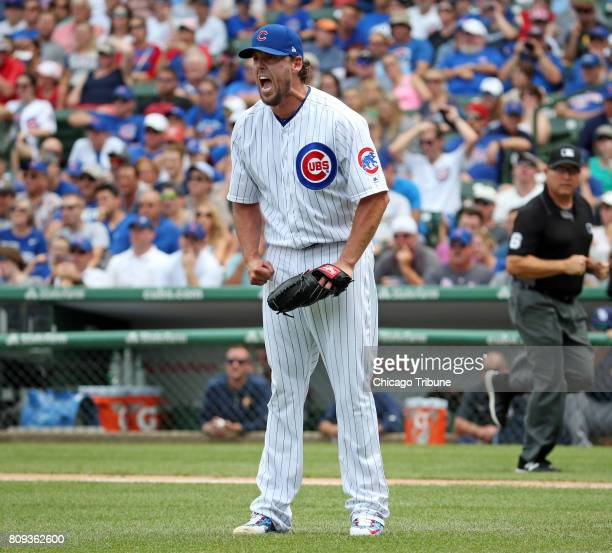 Chicago Cubs starting pitcher John Lackey reacts as he allows an RBI double to Tampa Bay Rays left fielder Corey Dickerson in the third inning on...
