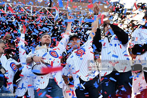 Chicago Cubs starting pitcher Jon Lester holds the commissioner trophy with Chicago Cubs first baseman Anthony Rizzo and Chicago Cubs third baseman...