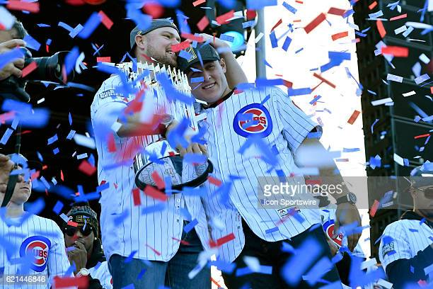 Chicago Cubs starting pitcher Jon Lester holds the commissioner trophy with Chicago Cubs first baseman Anthony Rizzo during the Chicago Cubs World...