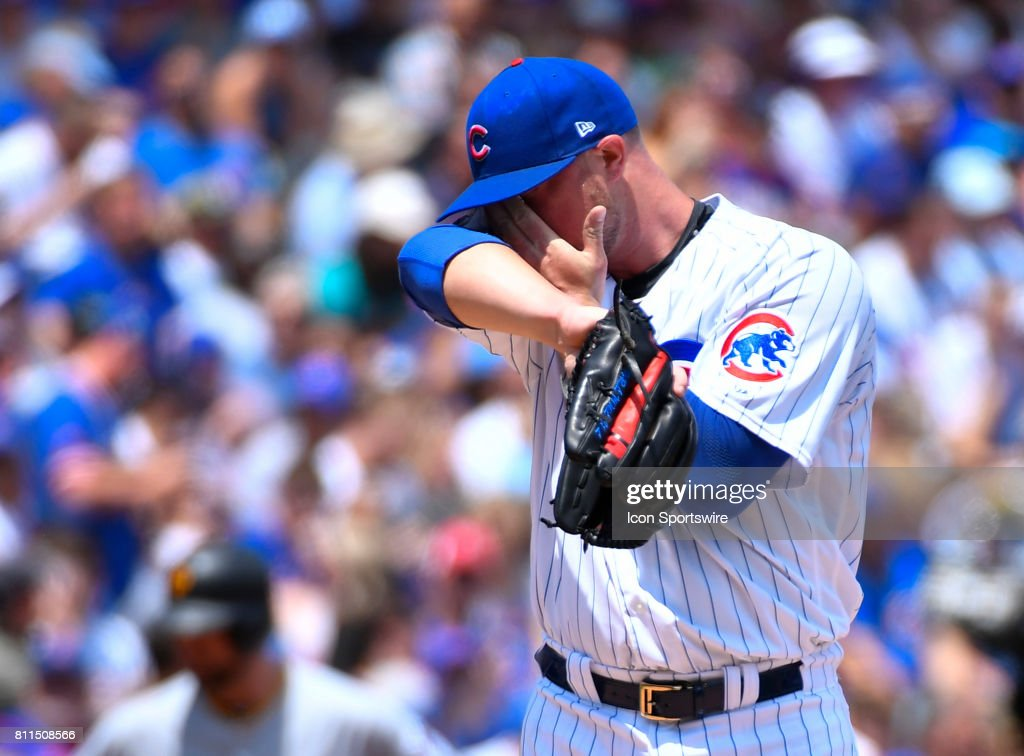 Chicago Cubs starting pitcher Jon Lester (34) wipes his face during the game between the Pittsburg Pirates and the Chicago Cubs on July 9, 2017 at Wrigley Field in Chicago, Illinois.