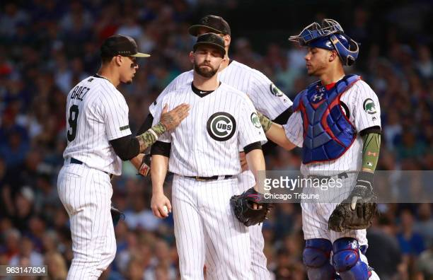 Chicago Cubs starting pitcher Tyler Chatwood with teammates just before being pulled in the third inning against the San Francisco Giants on Sunday...