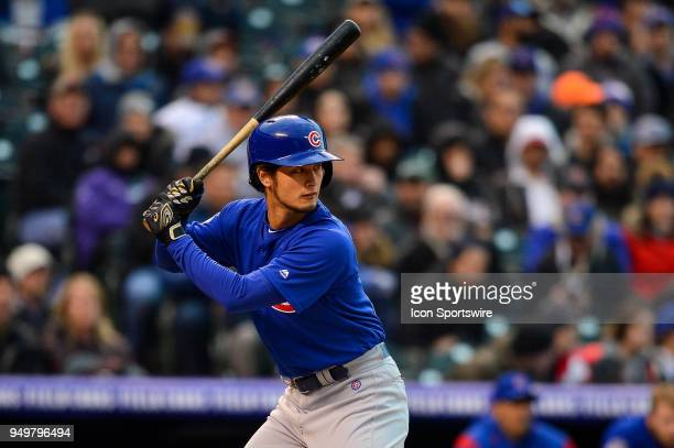 Chicago Cubs starting pitcher Yu Darvish bats against the Colorado Rockies during a regular season Major League Baseball game between the Chicago...