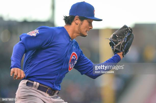 Chicago Cubs starting pitcher Yu Darvish forces a runner out at first base during a regular season Major League Baseball game between the Chicago...