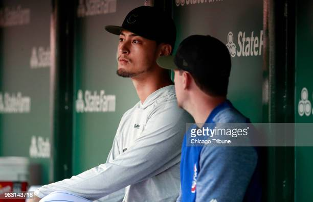Chicago Cubs starting pitcher Yu Darvish left sits with Chicago Cubs starting pitcher Kyle Hendricks in the dugout during the first inning against...