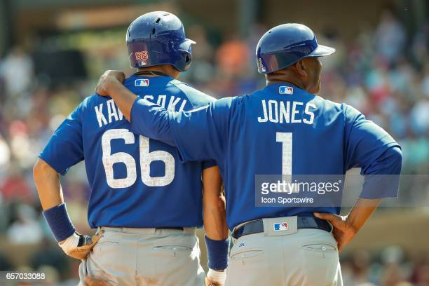 Chicago Cubs third base coach Gary Jones gives Chicago Cubs shortstop Munenori Kawasaki some encouragement during the spring training baseball game...