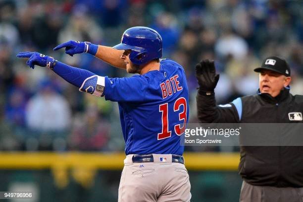 Chicago Cubs third baseman David Bote celebrates after hitting a second inning double for his first major league hit against the Colorado Rockies...