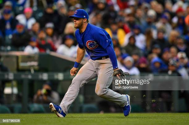 Chicago Cubs third baseman David Bote charges to field a bunt against the Colorado Rockies during a regular season Major League Baseball game between...