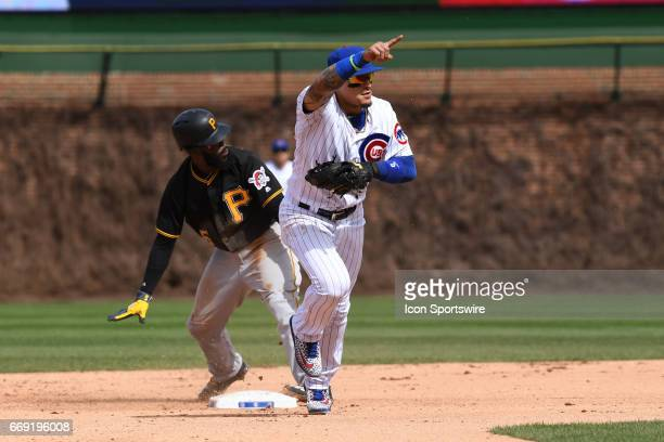 Chicago Cubs third baseman Javier Baez celebrates after tagging out Pittsburgh Pirates second baseman Josh Harrison during a game between the...