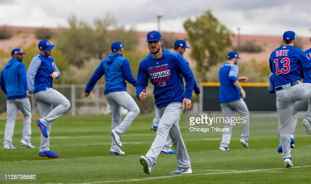Chicago Cubs third baseman Kris Bryant center stretches with teammates Monday Feb 18 2019 during spring training in Mesa Ariz