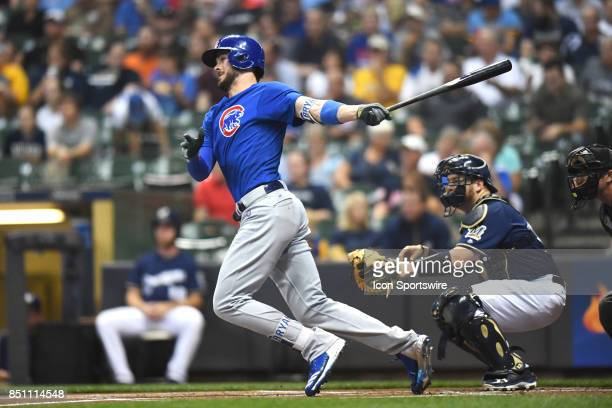 Chicago Cubs third baseman Kris Bryant hits a single in the first inning during a game between the and the Chicago Cubs the Milwaukee Brewers on...