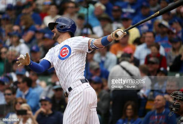 Chicago Cubs third baseman Kris Bryant hits a solo home run in the third inning against the Milwaukee Brewers on Sunday May 21 2017 at Wrigley Field...