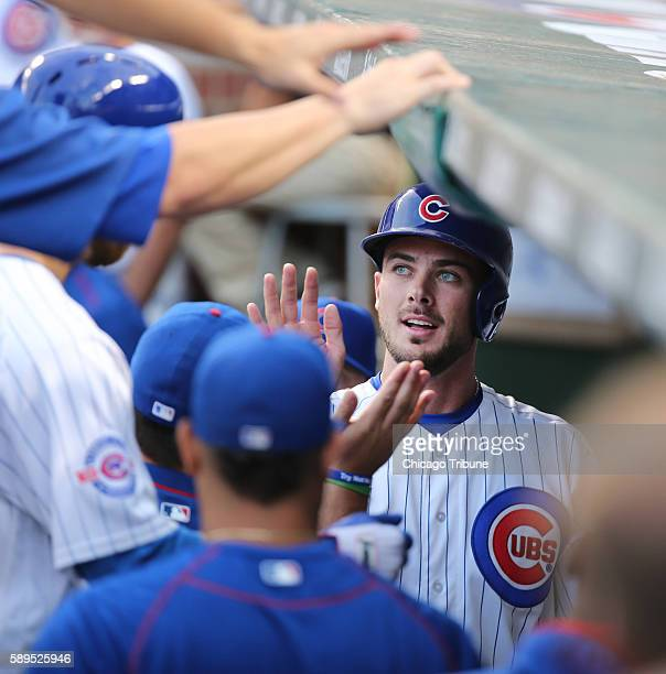 Chicago Cubs third baseman Kris Bryant in the dugout after scoring on a sacrifice fly hit by Chicago Cubs second baseman Ben Zobrist against the St...