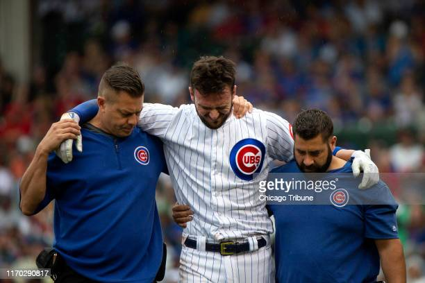 Chicago Cubs third baseman Kris Bryant leaves the game after an injury at first during the third inning against the St. Louis Cardinals on Sunday,...