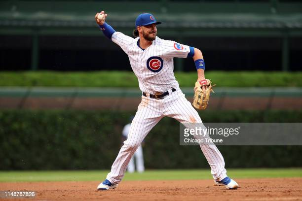 Chicago Cubs third baseman Kris Bryant makes a throwing error on a ground ball by St. Louis Cardinals left fielder Marcell Ozuna in the second inning...