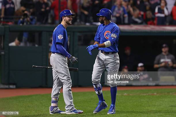 Chicago Cubs third baseman Kris Bryant reacts to Chicago Cubs center fielder Dexter Fowler after Fowler's leadoff home run during game 7 of the 2016...