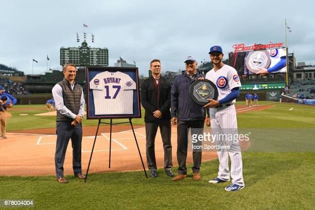 Chicago Cubs third baseman Kris Bryant receives the National League MVP award prior to a game between the Philadelphia Phillies and the Chicago Cubs...