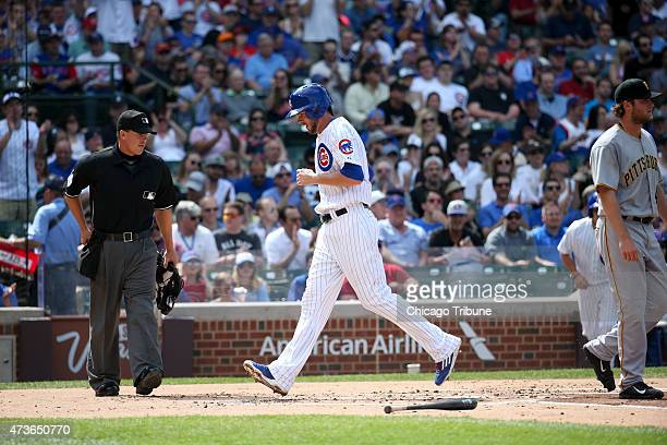 Chicago Cubs third baseman Kris Bryant scores a run against the Pittsburgh Pirates during the first inning on Saturday, May 16 at Wrigley Field in...