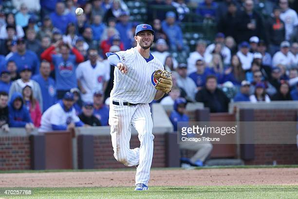 Chicago Cubs third baseman Kris Bryant throws the ball to first base during the 10th inning against the San Diego Padres at Wrigley Field in Chicago...
