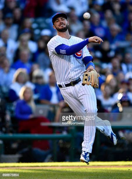 Chicago Cubs third baseman Kris Bryant throws the ball to first base for the out during the game between the San Diego Padres and the Chicago Cubs on...