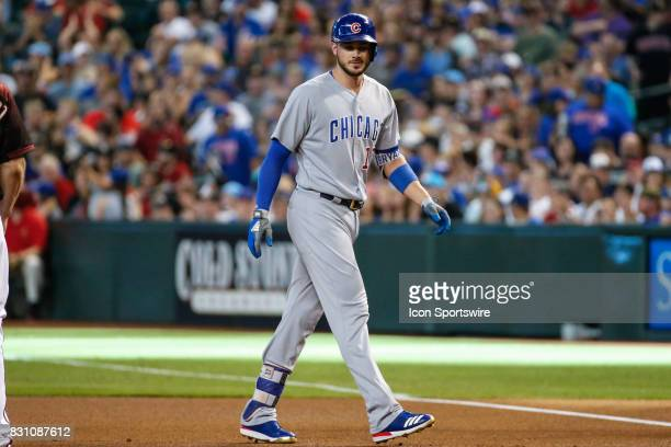 Chicago Cubs third baseman Kris Bryant walks back to first base after hitting a single during the MLB baseball game between the Chicago Cubs and the...