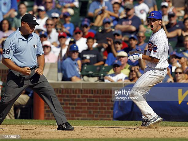 Chicago Cubs' Tyler Colvin reacts to an out call by first base umpire Mark Carlson on the gameending double play in the 10th inning of a Major League...