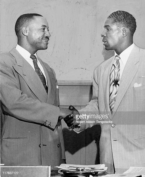 Chicago Defender publisher John H Sengstacke shakes the hand of Chicago White Sox outfielder Saturnino 'Minnie' Minoso Chicago IL 1951