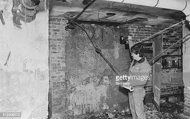 Demolition supervisor Chris Joanet inspects mysterious vault in the abasement of Chicago's south side Lexington Hotel former hangout of mobster Al...