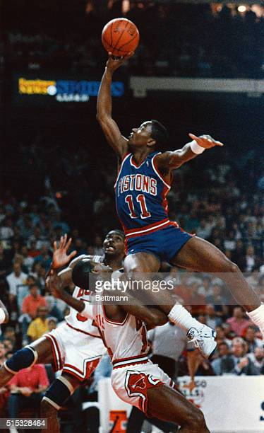Detroit Pistons Isiah Thomas flies above Chicago Bulls' Horace Grant and Craig Hodges in the 1st quarter of their playoff game