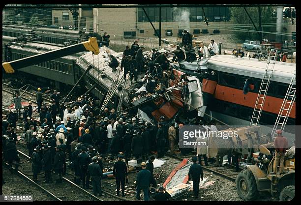 Dozens of firemen and other rescue personnel work to free victims from twisted wreckage of two Illinois Central Gulf Railroad commuter trains here A...