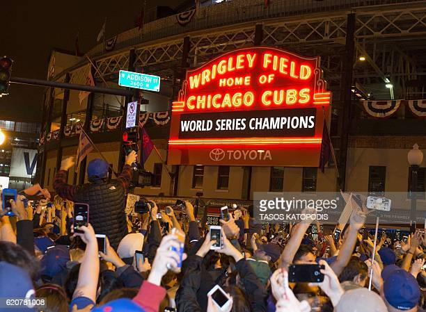 Chicago fans celebrate the Chicago Cubs 87 victory over the Cleveland Indians in Cleveland in 10th inning in game seven of the 2016 World Series...