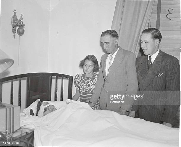 Feller Visits Mother Hit By Foul Ball Bob Feller Cleveland Indians pitching star at the bedside of his mother Mrs William Feller of Van Meter Iowa...