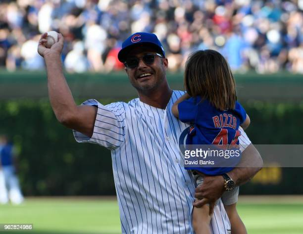 Chicago Fire actor Taylor Kinney throws out a ceremonial first pitch before the game between the Chicago Cubs and the San Francisco Giants on May 26...