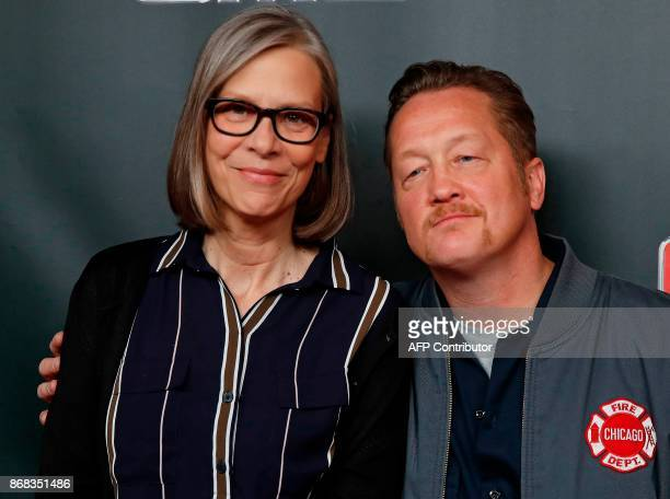 'Chicago Fire' cast member Christian Stolte arrives on the red carpet with 'Chicago PD' cast member Amy Morton at the 3rd Annual OneChicago Press Day...