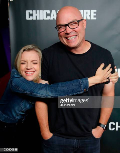 Chicago Fire cast member Kara Killmer hugs executive producer Derek Haas as they arrive on the red carpet for the 4th Annual OneChicago Press Day in...