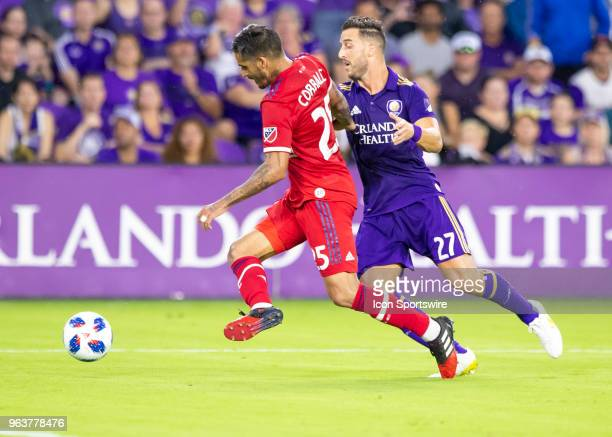 Chicago Fire defender Jorge Luis Corrales takes the ball away from Orlando City defender RJ Allen during the MLS soccer match between the Orlando...