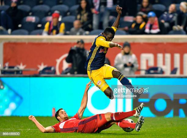 Chicago Fire defender Matt Polster slides tackles New York Red Bulls defender Kemar Lawrence tangle during the MLS Cup Playoff match between the New...