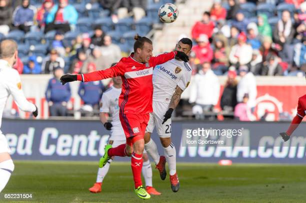Chicago Fire defender Michael Harrington and Real Salt Lake midfielder Ricardo Velazco play a ball in the second half during an MLS soccer match...
