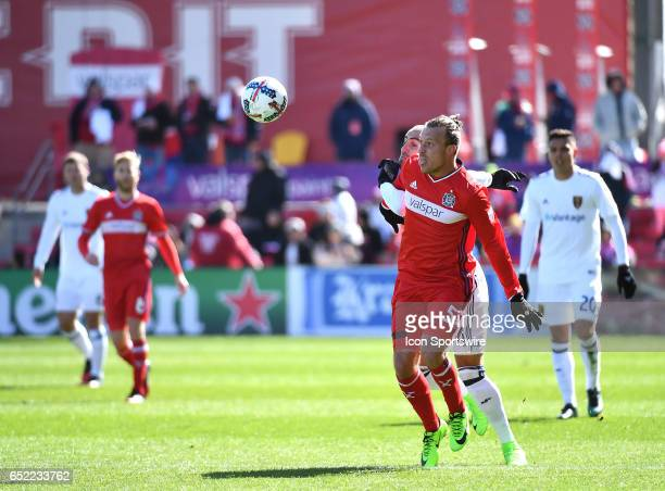 Chicago Fire defender Michael Harrington shields the ball against Real Salt Lake forward Yura Movsisyan during the game between the Real Salt Lake...