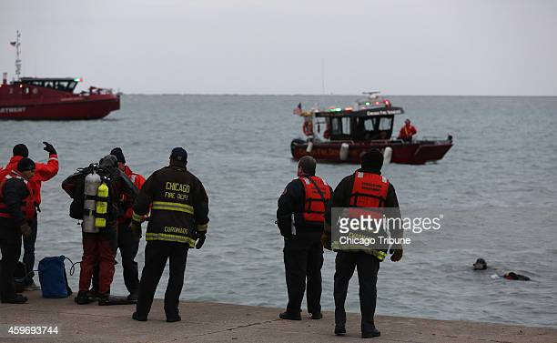 Chicago Fire Department divers search for a car that fell into Lake Michigan near Balbo and Lake Shore Drive on Friday Nov 28 2014 in Chicago One...