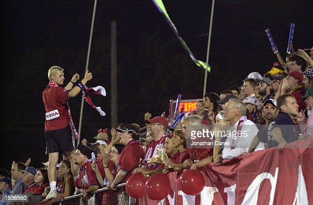 Chicago Fire fans celebrate after the MLS playoff game against the New England Revolution on September 29, 2002 at Cardinal Stadium in Naperville,...