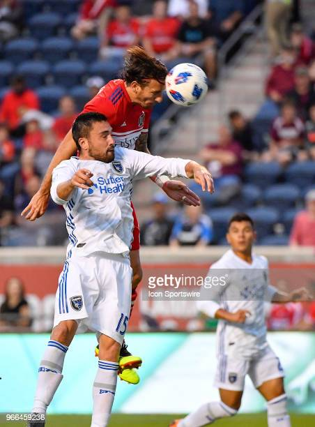 Chicago Fire forward Alan Gordon heads the ball for a goal against San Jose Earthquakes defender Jimmy Ockford on June 2 2018 at Toyota Park in...