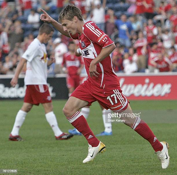 Chicago Fire forward Chris Rolfe celebrates his goal against the New York Red Bulls during the first half, at Toyota Park in Bridgeview, Ill.,...