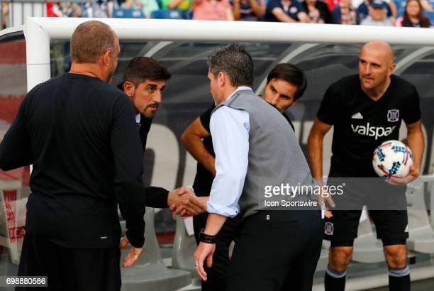 Chicago Fire head coach Veljko Paunovic and New England Revolution head coach Jay Heaps shake hands before a regular season MLS match between the New...